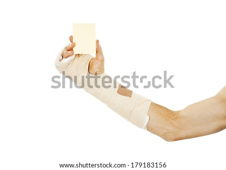 Broken arm bone in cast holding a blank card. Isolated on white background  - stock photo