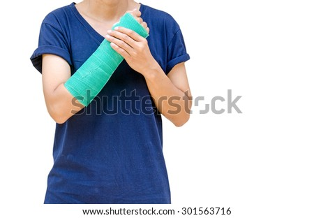 broken arm with green cast isolated on white