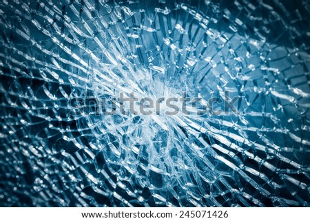 broken armoured glass closeup , background of glass was smashed - stock photo