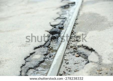 Broken asphalt close up - stock photo