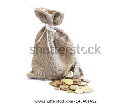 broken bag of money with coins - stock photo