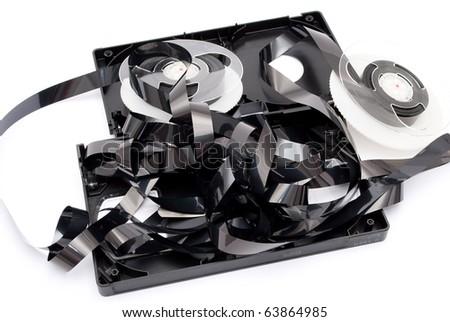 Broken black video cassette - stock photo