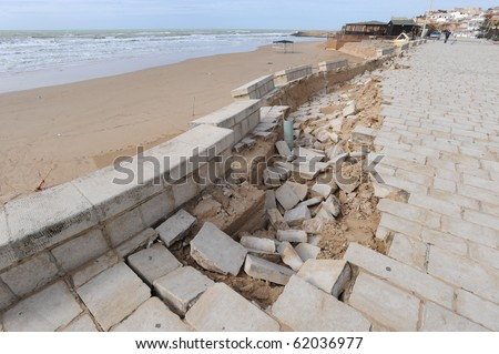 Broken bricks wall againts seaview, sicily, italy - stock photo