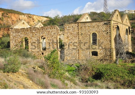 Broken buildings at an abandoned mine site - stock photo