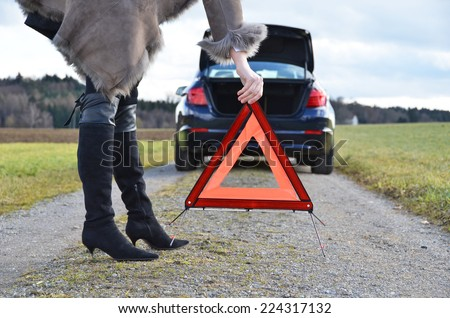 Broken car, girl and warning triangle  - stock photo