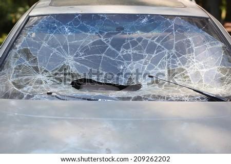 broken car windshield cracks - stock photo