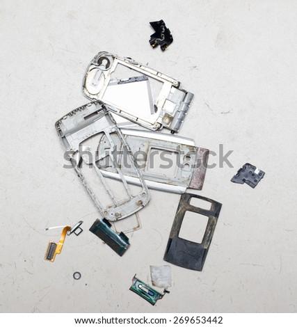 broken cell phone - stock photo