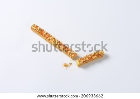 broken cheese stick with crumbs - stock photo