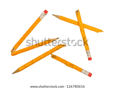 Broken Chewed Pencils Scattered Isolated on a white background. - stock photo