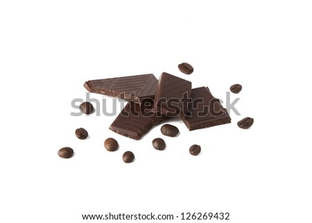 Broken chocolate bar and coffee beans on a white background