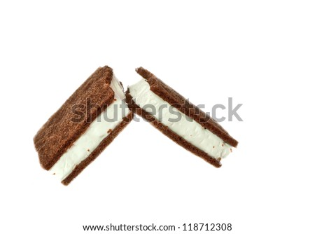 Broken chocolate biscuits on a white background