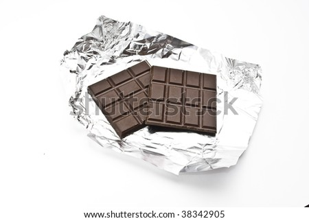 Broken chocolate on a foil - stock photo
