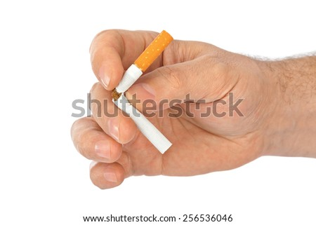 Broken cigarette in hand isolated on white background - stock photo