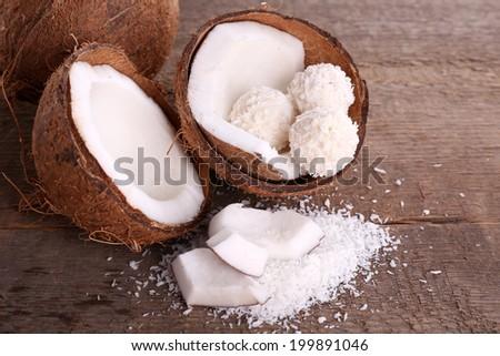Broken coconut on wooden background - stock photo