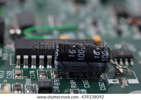 Broken detail on digital hardware closeup. Microchips and condensers assembly on the circuit board macro - stock photo