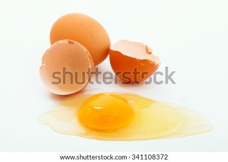 Broken egg on white background - stock photo