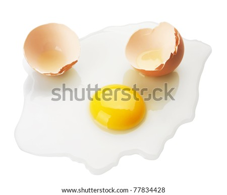Broken egg on white background - stock photo