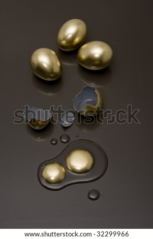 Broken eggs with a black background - stock photo
