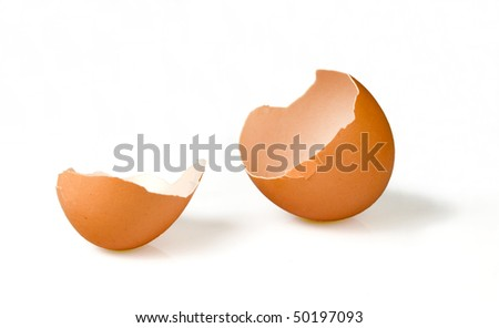 Broken empty egg in white background (with clipping path) - stock photo