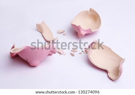 broken empty piggy bank isolated on white - stock photo