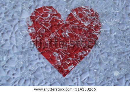 Broken glass and heart - stock photo