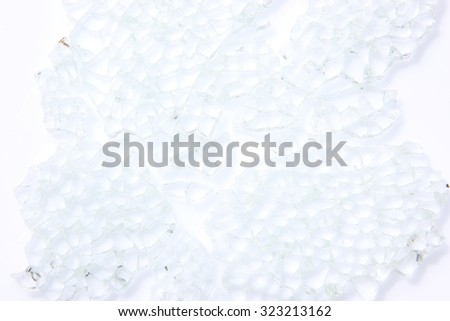 Broken glass background isolated on white. - stock photo