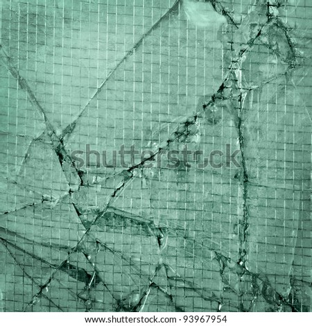 broken glass background of cracked window with wires green - stock photo
