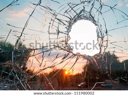 broken glass by the street at dusk - stock photo