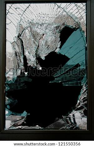 Broken glass door of the shop - stock photo