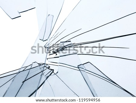 Broken glass fragments above white. Abstract background texture - stock photo