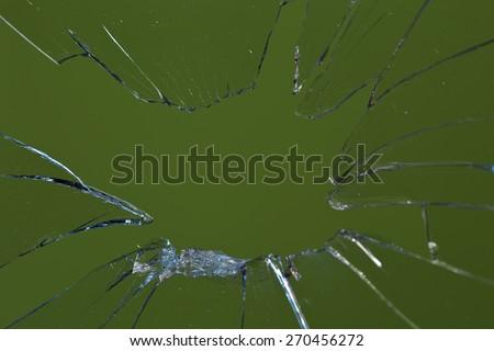 broken glass green background - stock photo