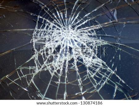 Broken glass in car - stock photo