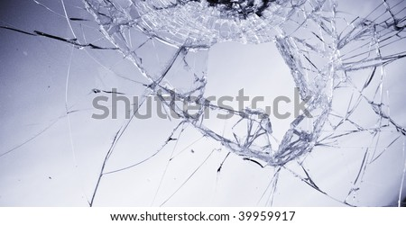 Broken glass in clear blue tone. - stock photo