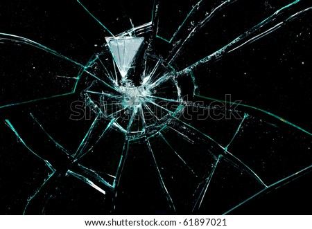 broken glass on a black background - stock photo