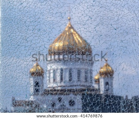 Broken glass  texture - cracked window close-up of broken glass can see the building of the orthodox  temple of Christ the Savior with gold domes against the sky. - stock photo