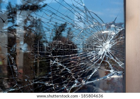 Broken Glass with outdoor street reflection. Closeup. - stock photo