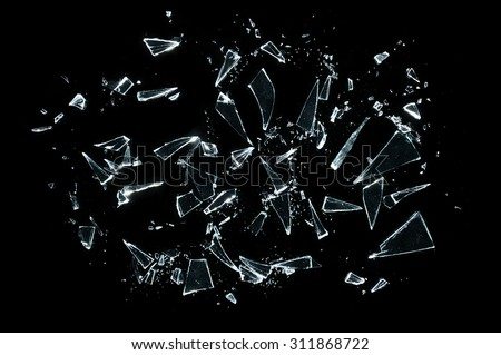broken glass with sharp Pieces over black  - stock photo