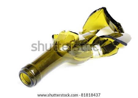 broken green wine bottle isolated on the white background - stock photo