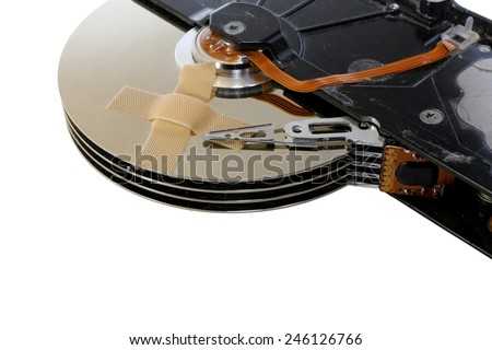broken hard drives with a band-aid over the disks - stock photo