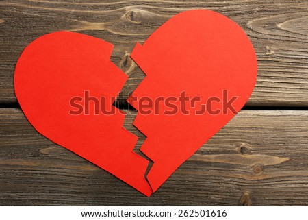 Broken heart on wooden background - stock photo