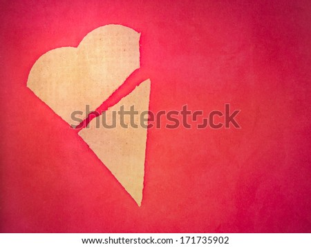 Broken heart shaped biscuit on pink background - stock photo