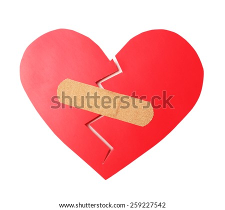 Broken heart with plaster isolated on white - stock photo