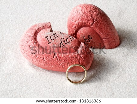 broken heart with ring - stock photo