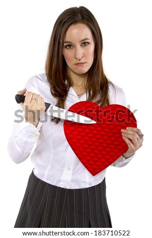 broken hearted ex-girlfriend with a heart and knife - stock photo