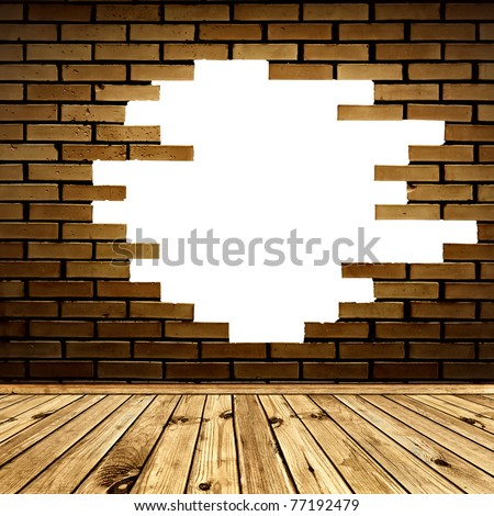 broken hole in the brick wall of room with wooden floor - stock photo