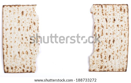 Broken in half Jewish traditional Pesach textured Matza bread substitute isolated on white background