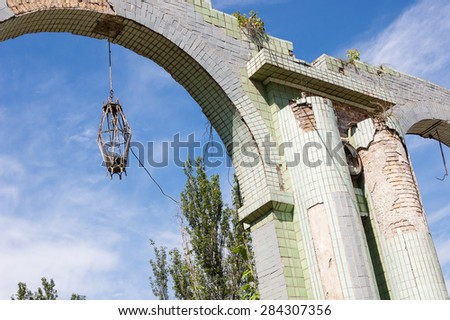 broken lanterns between two old columns, abandoned arch - stock photo