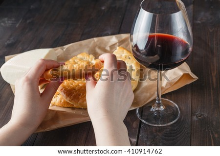 Broken loaf of bread and glass of red wine