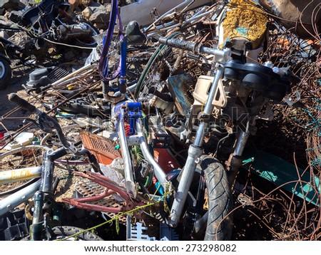 Broken motorcycle  with other scrap metals - stock photo