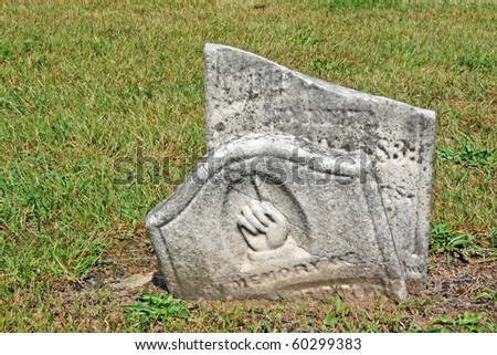 Broken nineteenth century gravestone with pointing hand - stock photo